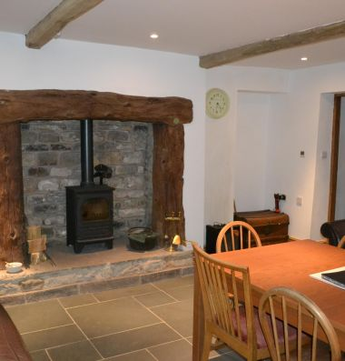 Dining area and wood burning stove.